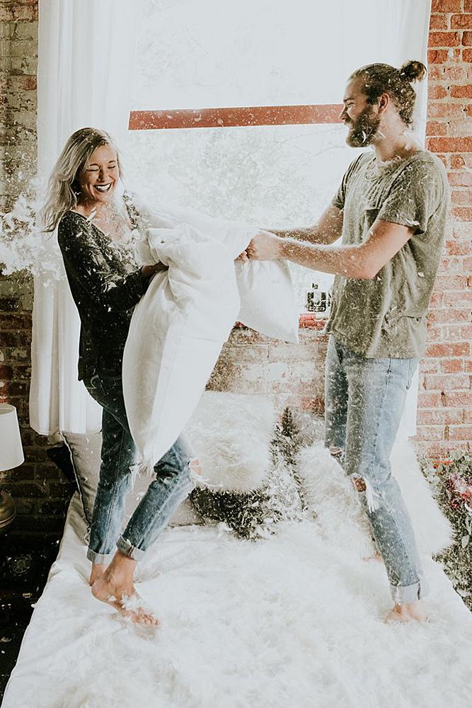 engagement photos couple pillow fight romantic cute