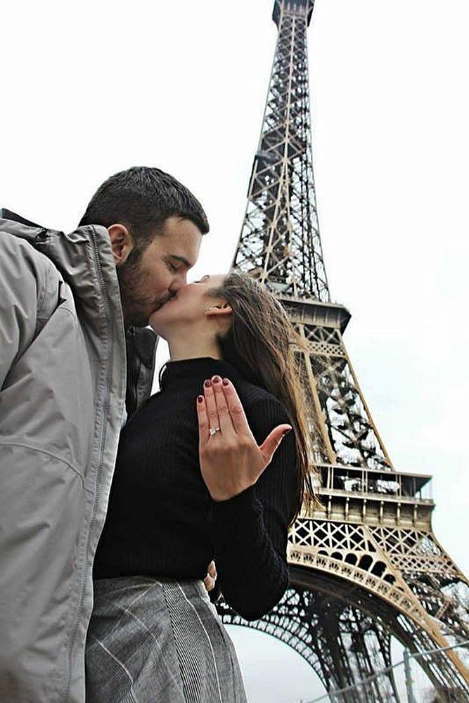 engagement photos proposal kiss ring on her finger in paris