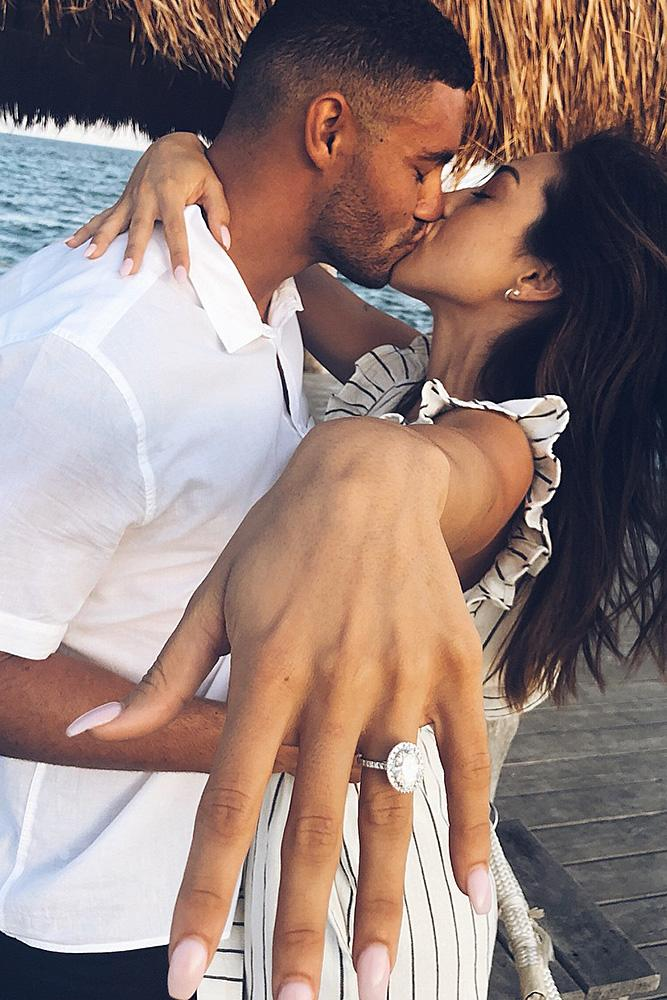 engagement photos proposal kiss ring on the finger white gold oval cut halo