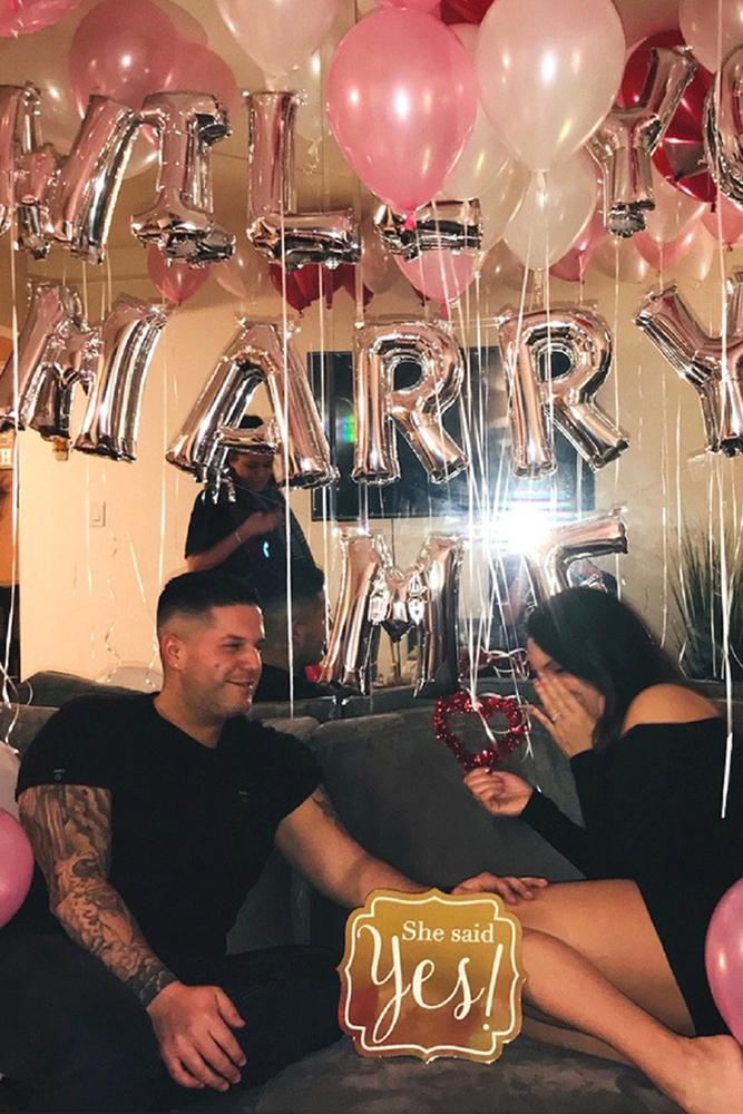 engagement pictures brightful decoration with ballons for two man and woman