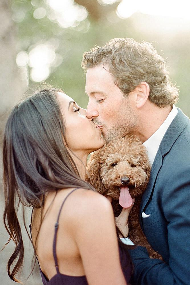engagement pictures with pets dog and kissing couple