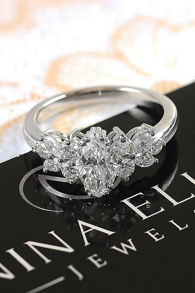 modern engagement rings round cut marquise cut white gold
