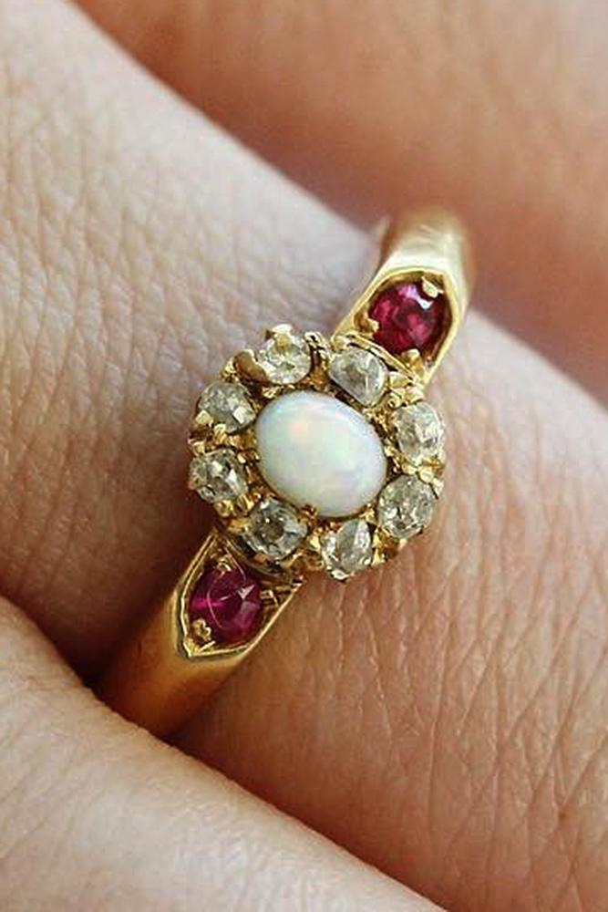 opal engagement rings oval cut floral halo gold