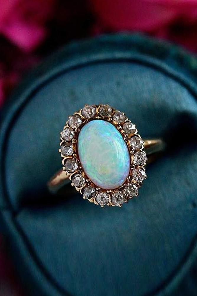 opal engagement rings oval cut floral halo gold vintage