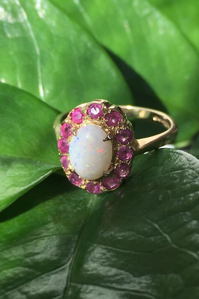 opal engagement rings ovalcut opalstone colorful gems halo