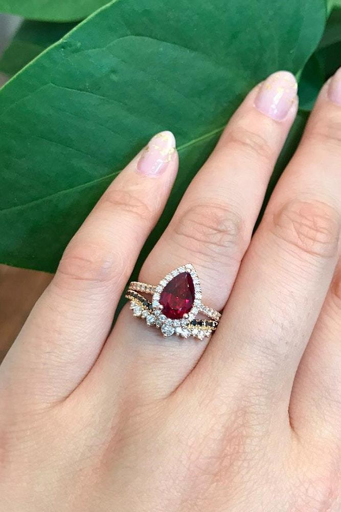 ruby engagement rings pear cut ruby halo rose gold pave band