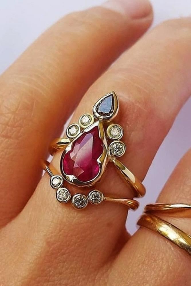 ruby engagement rings pear cut ruby yellow gold modern