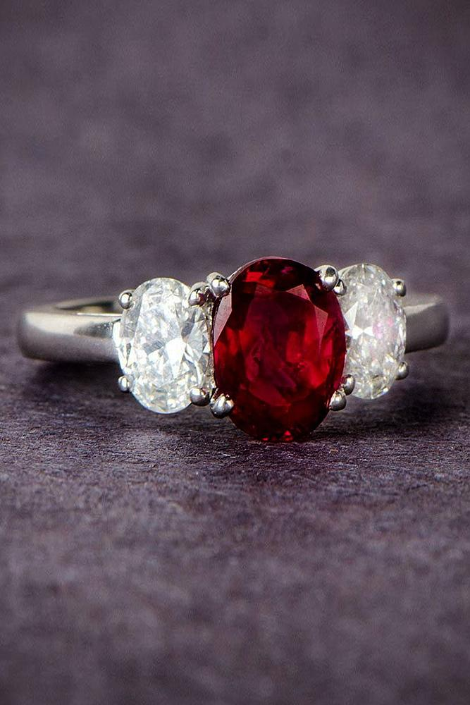 ruby engagement rings three stones oval cut gold
