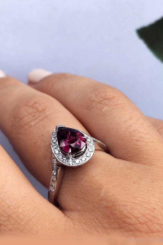 ruby engagement rings white gold pear cut ruby halo