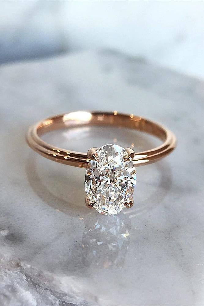30 simple engagement rings for girls who love classic oh so simple engagement rings rose gold oval cut diamond junglespirit Images