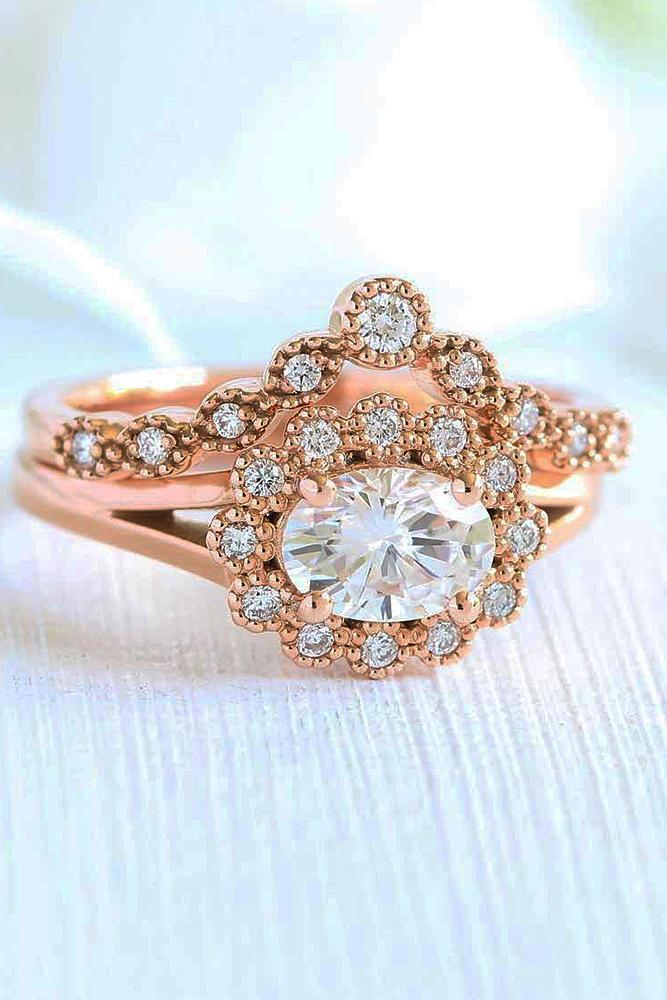 vintage wedding rings oval cut diamond floral halo