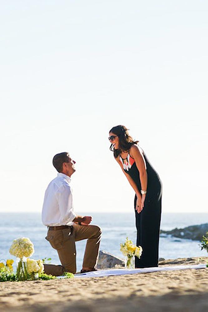 wedding proposal proposal on the beach couple