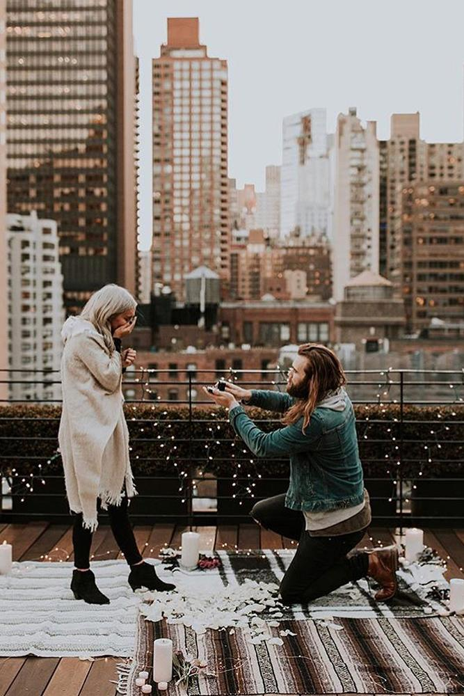 wedding proposal on the roof with candles she surprised