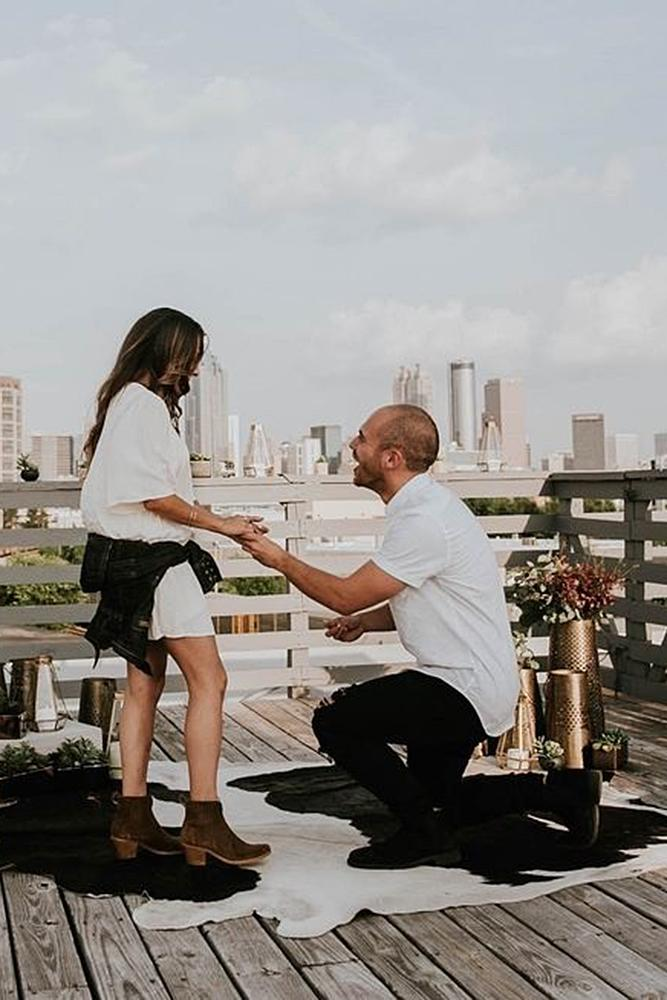 best proposals engaged couple on the roof