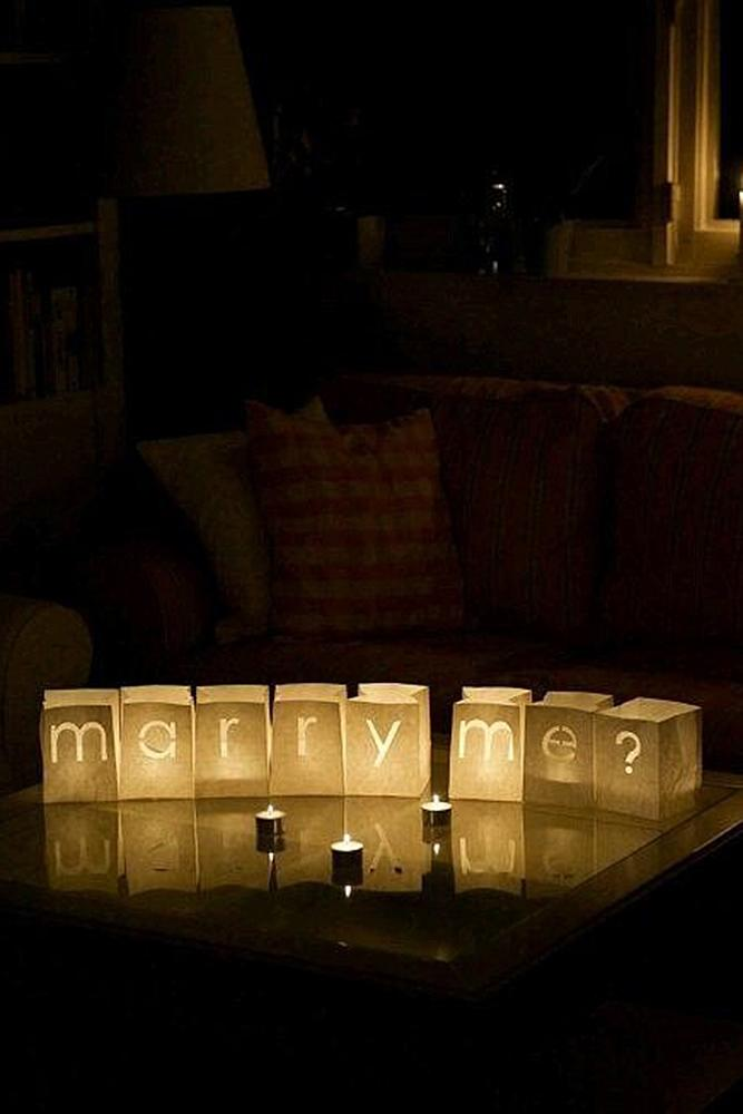 creative proposal ideas candles lightning romantic