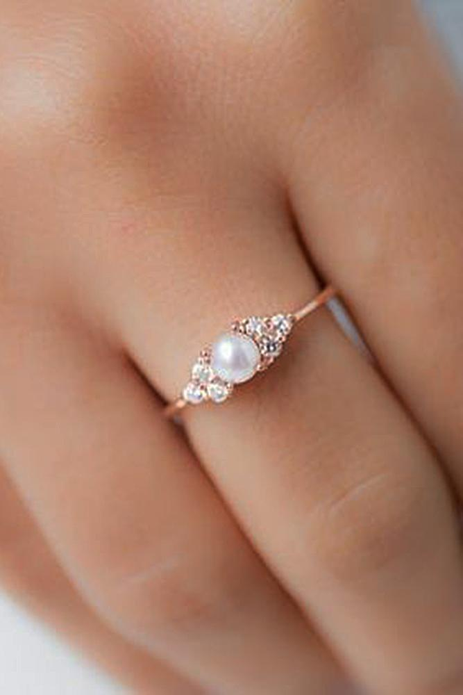 pearl engagement rings rose gold three stones