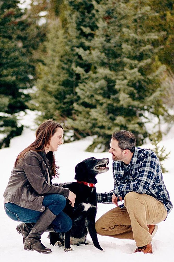 winter engagement photos couple engaged cute dog