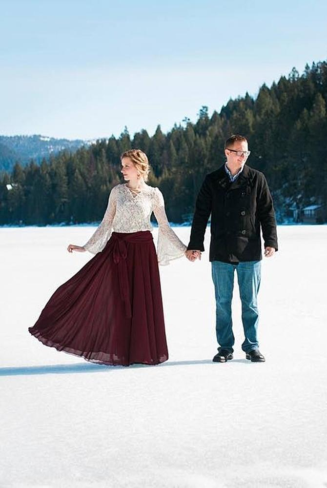 winter engagement photos couple photo with fantastic backdrop
