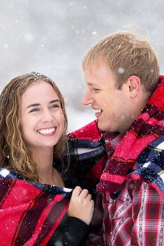 winter engagement photos man and woman plaid snow