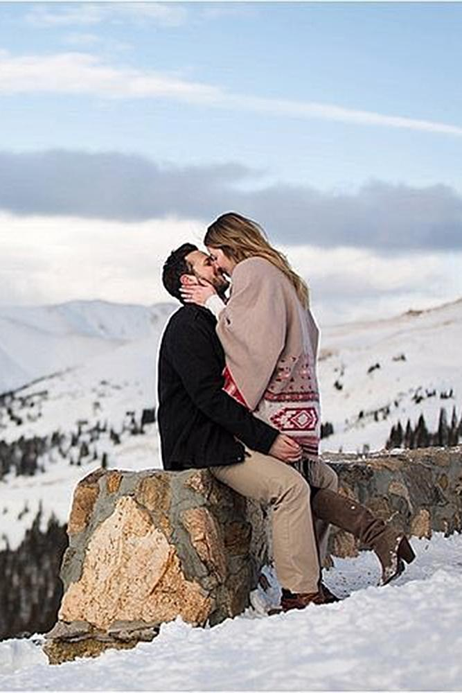 winter engagement photos man and women nature