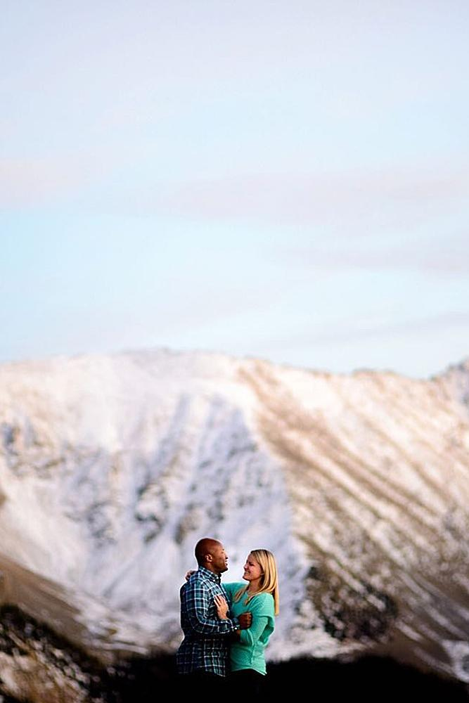 winter engagement photos mountains couple engaged
