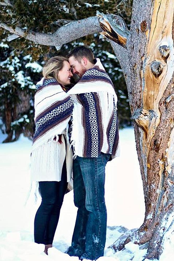 winter engagement photos plaid couple engaged forest