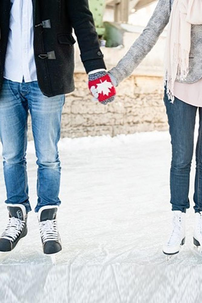 winter engagement photos skates man engage a woman