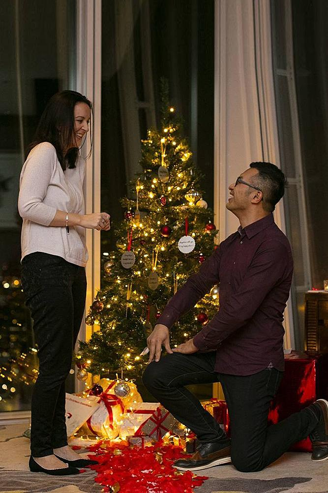 christmas proposal couple propose tree