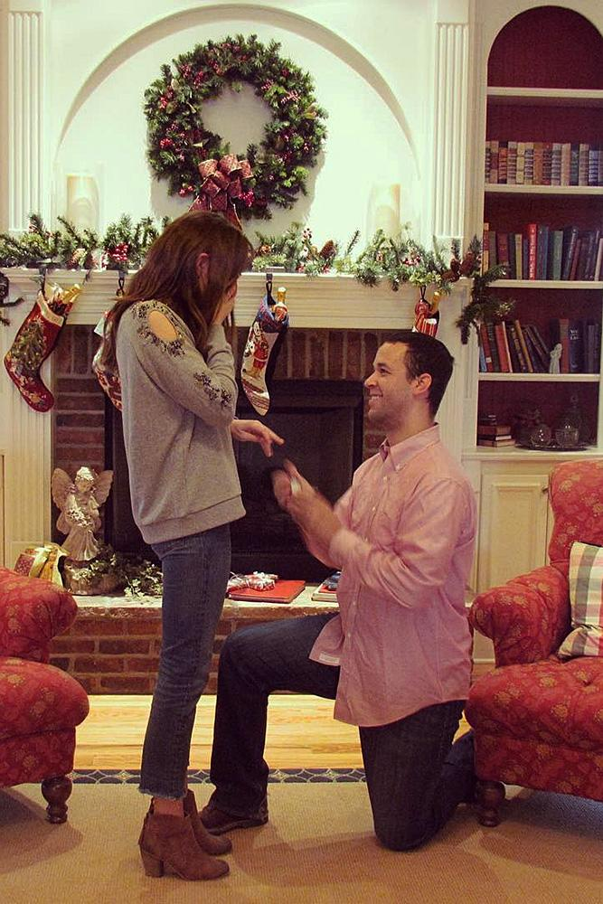 christmas proposal man propose a woman at home