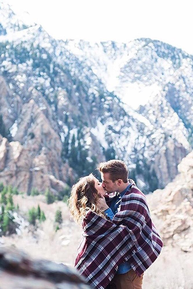 christmas proposal mountains couple romantic