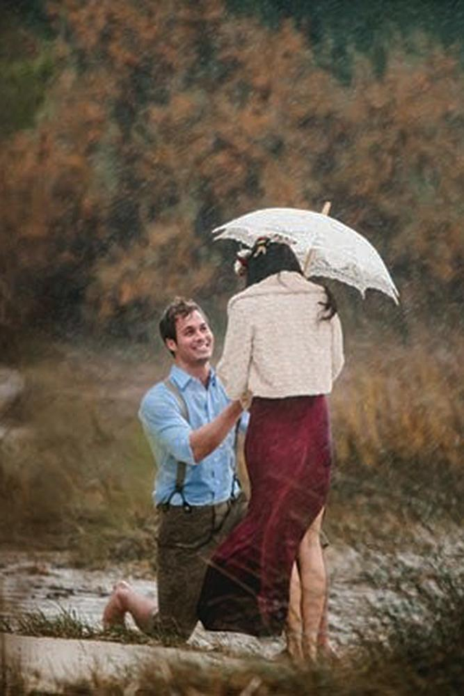christmas proposal rain couple