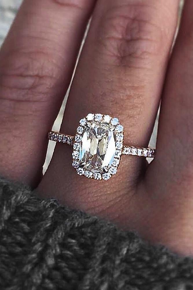 engagement ring designers emerald cut diamond pave band halo