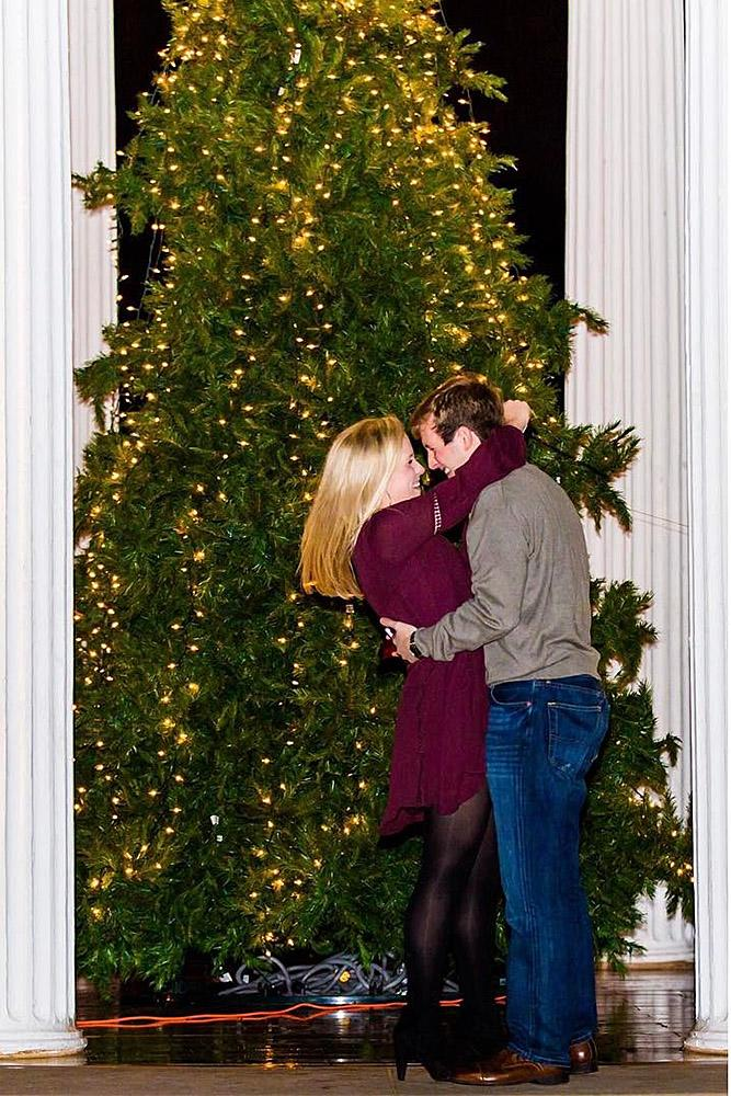 new year engagement photos couple at the city kiss