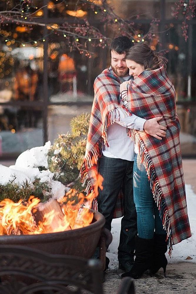 new year engagement photos engaged couple near fireplace