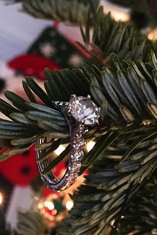 new year engagement photos engagement ring on the tree surprise