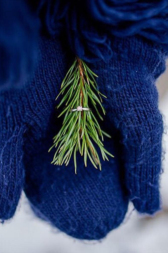 new year engagement photos ring at the tree in the hand