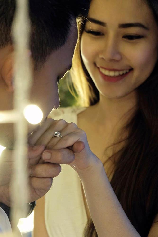 proposal kiss with engagement ring