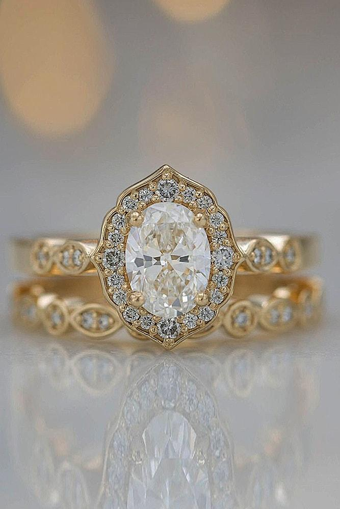 best vintage engagement rings yellow gold oval cut gemstone halo pave band unique
