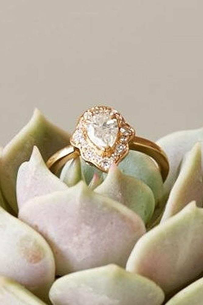 best vintage engagement rings yellow gold pear cut diamond halo pave band simple