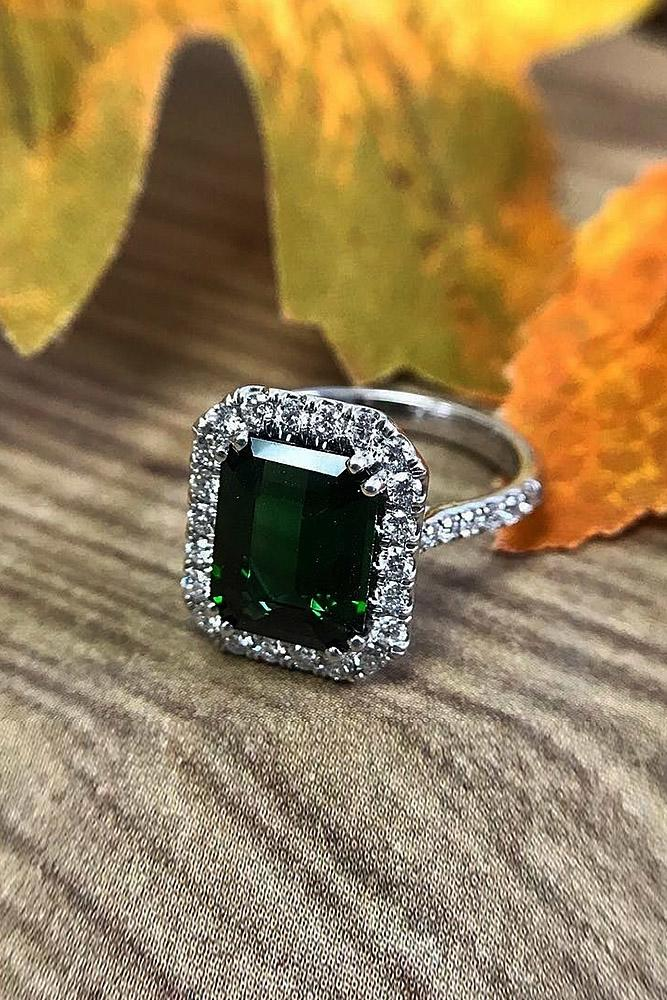 halo engagement rings emerald cut sapphire white gold