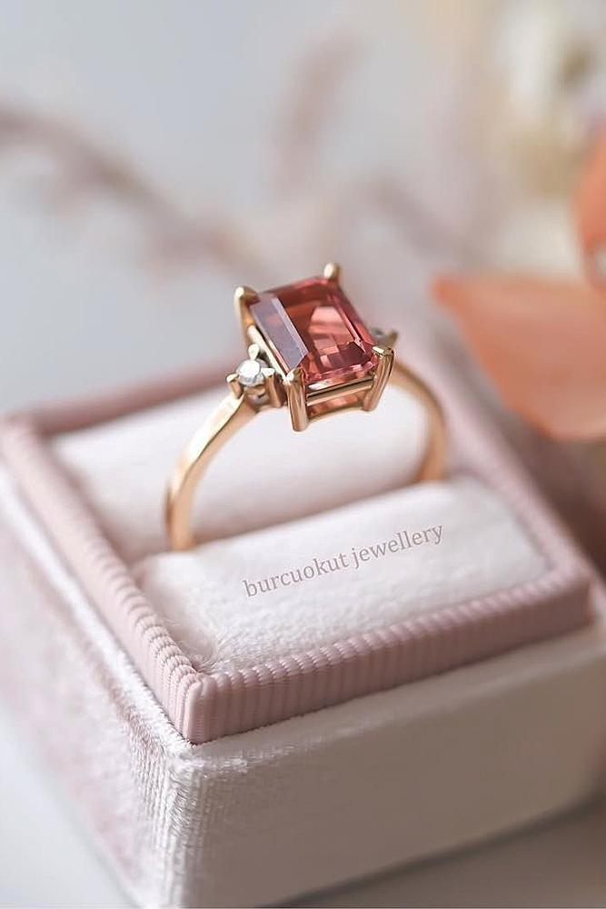 rose gold solitaire ring emerald cut gemstone simple