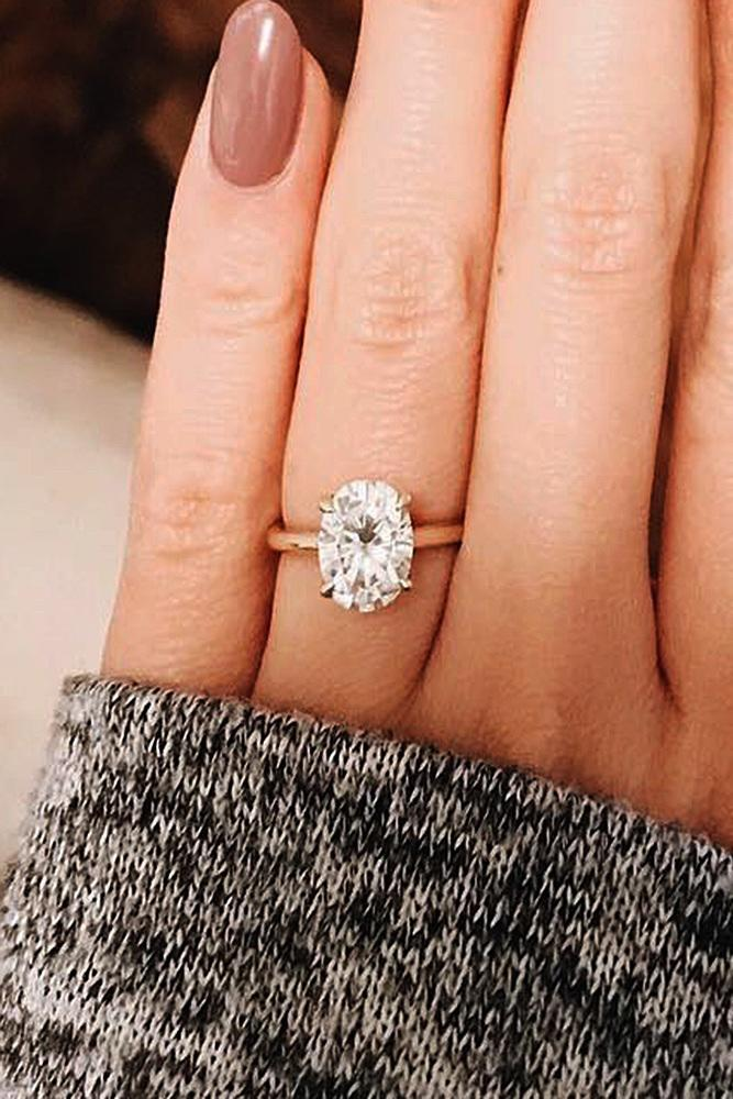 rose gold solitaire ring simple diamond oval cut