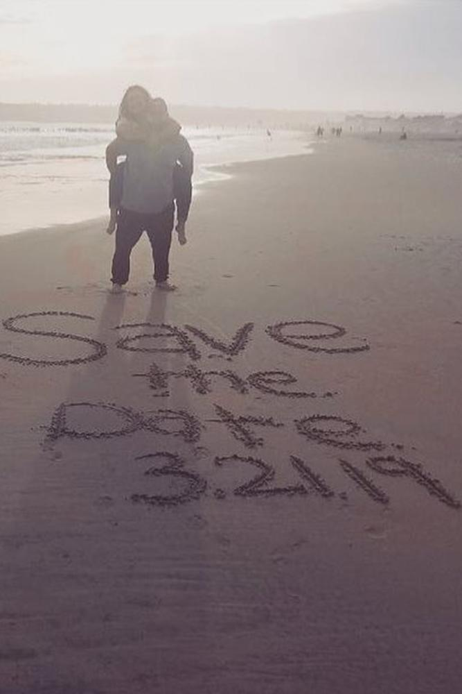 save the proposal date a couple on a beach date saved