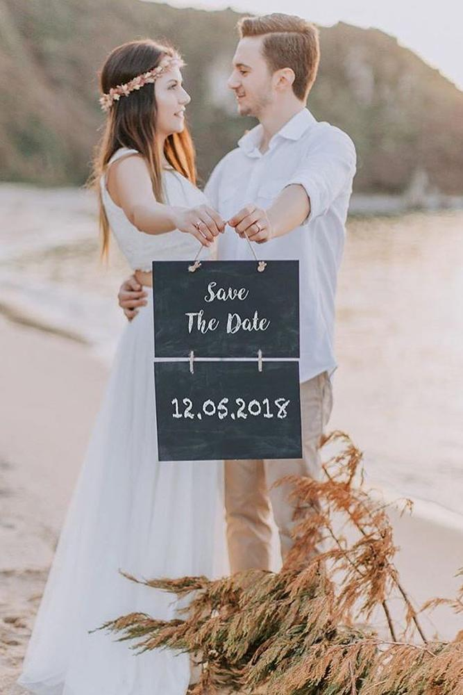 save the proposal date two in love with blackbord by the sea
