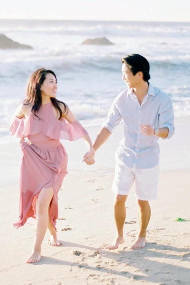 best beach proposal engagment while walking on a seashore