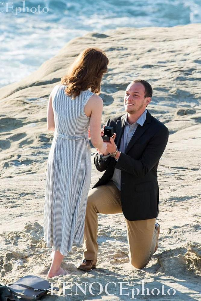best beach proposal man bending on a knee asks for marriage