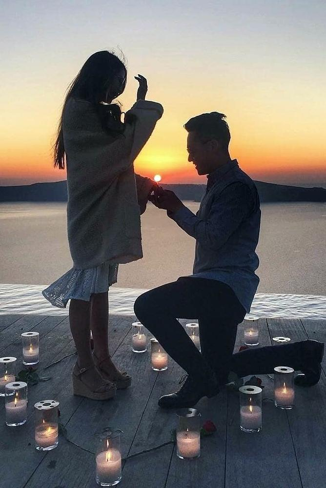 best beach proposal with romantic candle dacoration