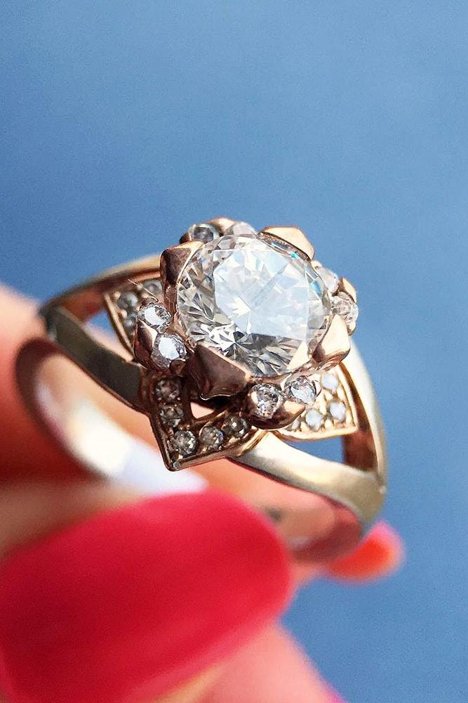 floral engagement rings rose gold round cut gemstone in the centre floral details split shank pave band