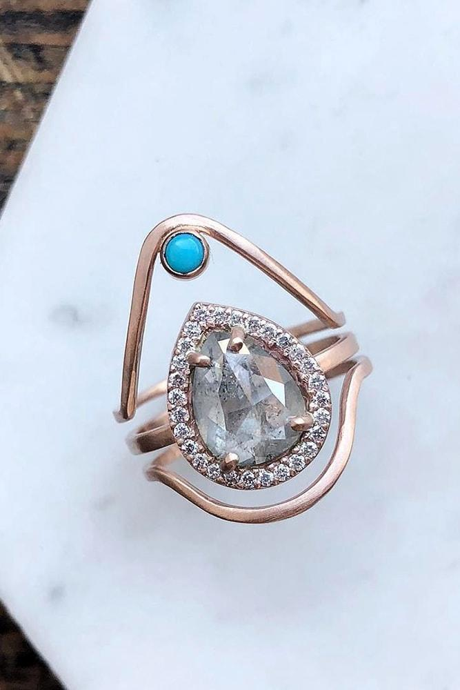 rose gold engagement rings modern ring pear cut gemstone halo unique design