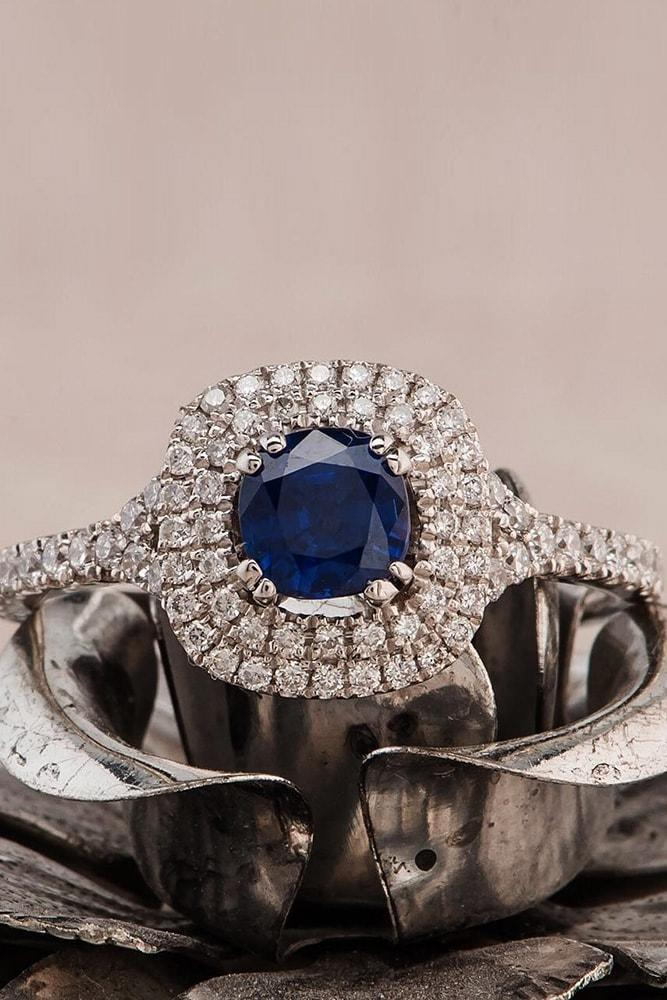 sapphire engagement rings white gold round cut blue sapphire in double diamond halo classic